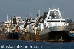 Factory Trawlers lined up at Port of Seattle Dock loading supplies for Fishing Trip to the Bering Sea in Alaska